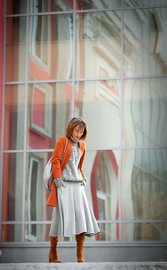 11-a-grey-a-line-midi-skirt-a-grey-sweater-mustard-tall-boots-an-orange-coat-to-add-color.jpg