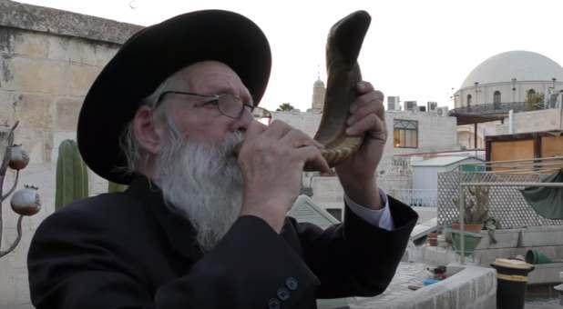 man-blowing-shofar-israel.jpg