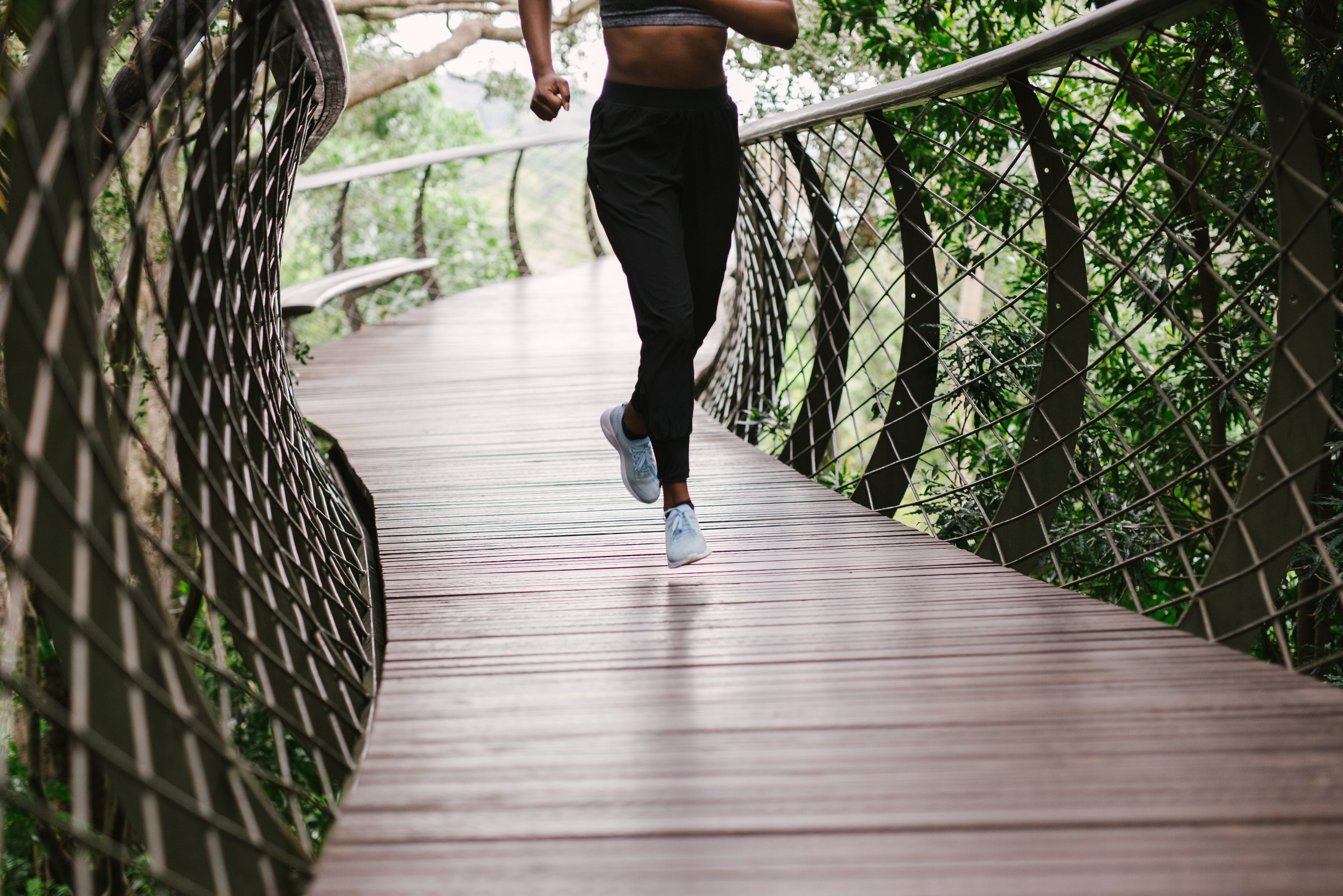photo-of-person-running-on-bridge-3059982.jpg