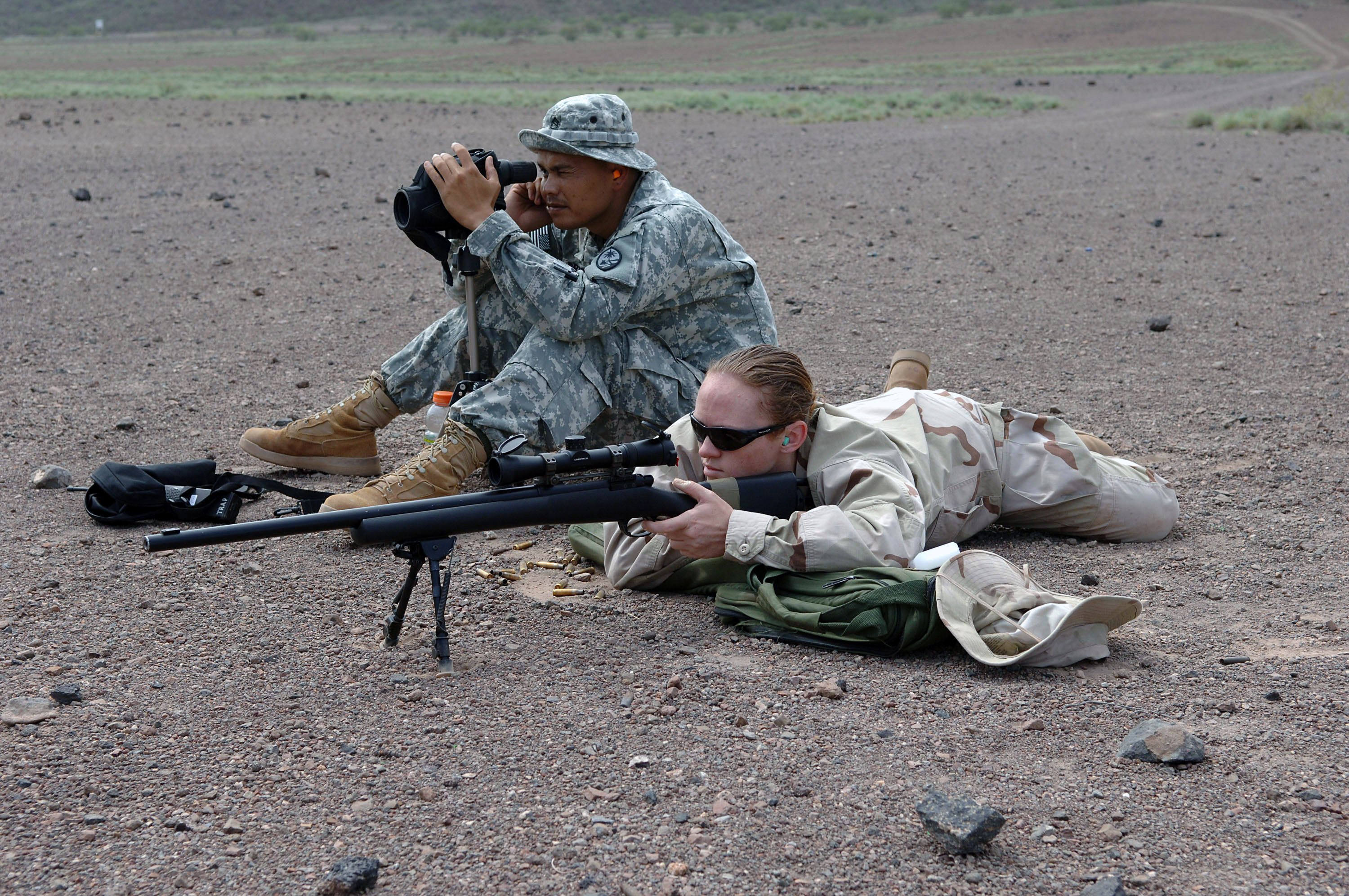 US_Navy_070825-N-3931M-035_Mass_Communication_Specialist_2nd_Class_Angela_McLane_fires_an_M-24_rifle_while_Sgt._1st_Class_Ronald_Brantley,_assigned_to_the_Guam_National_Guard_Delta_Company,_1st_Battalion,_294th_I.jpg