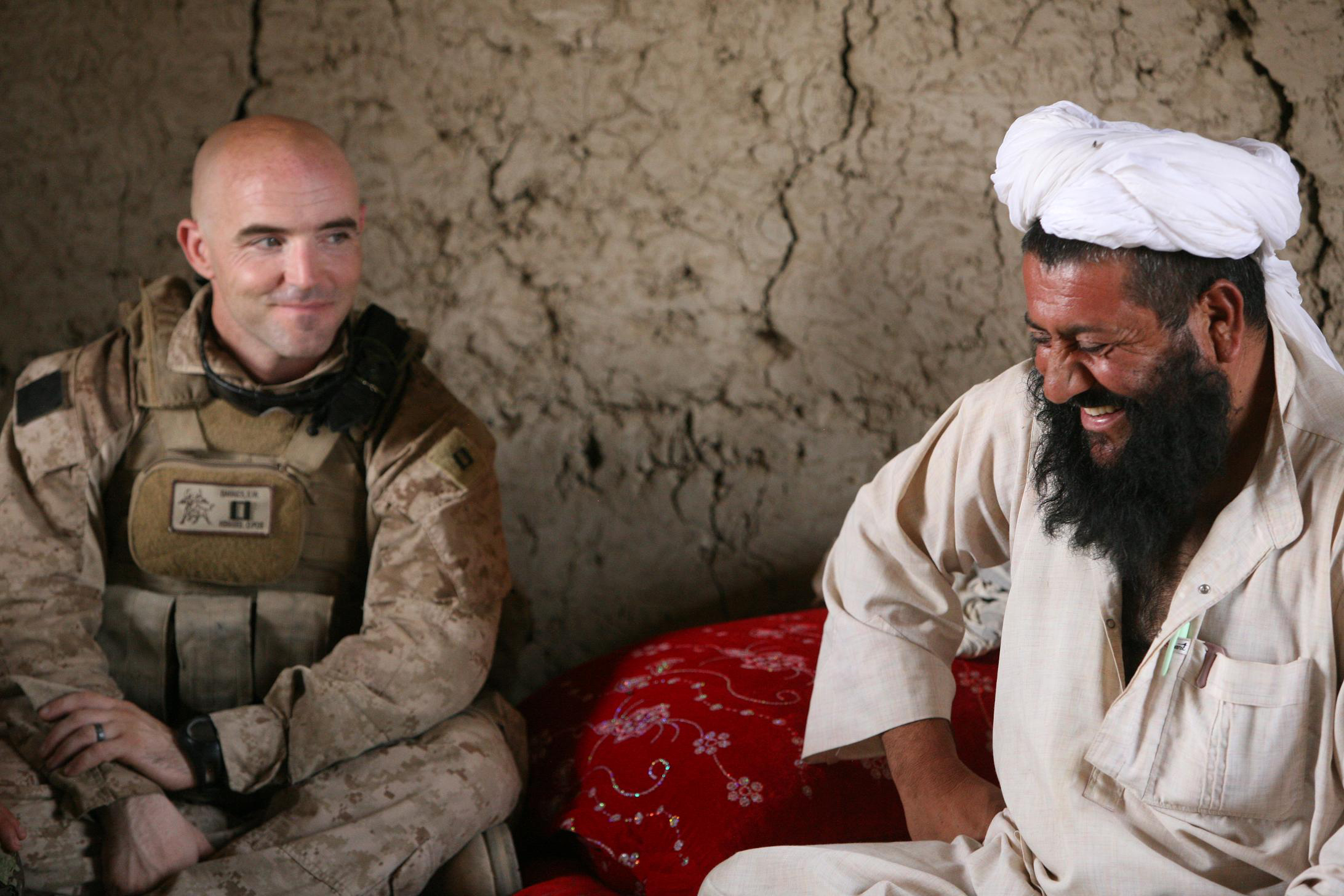 Defense.gov_News_Photo_100807-M-7038Y-028_-_U.S._Marine_Corps_Capt._Sean_Barnes_left_with_3rd_Battalion_1st_Marine_Regiment_Regimental_Combat_Team_7_listens_as_an_Afghan_National_Army (1).jpg