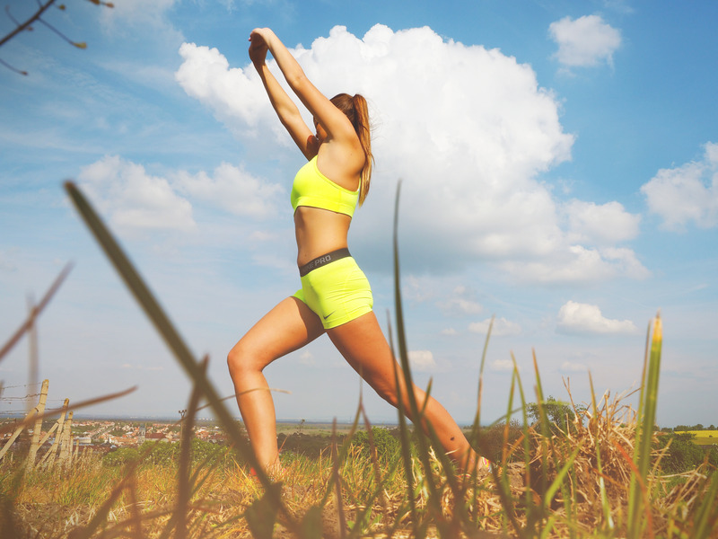 canva-woman-in-yellow-sports-bra-stretching-near-green-grass-field-madgw1b4a4e.jpg