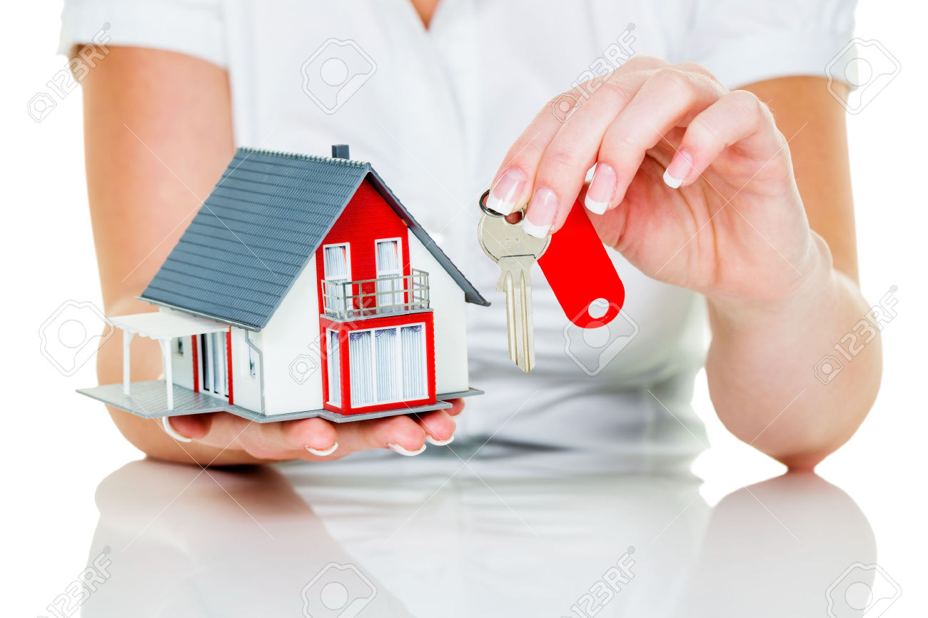 29210870-a-broker-for-real-estate-with-a-house-and-a-key-successful-leasing-and-property-for-sale-by-real-est-stock-photo.jpg
