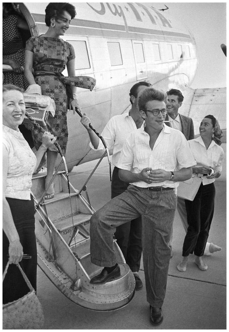 james-dean-and-elizabeth-taylor-board-the-plane-to-texas-photographed-by-richard-miller-1955-life.jpg