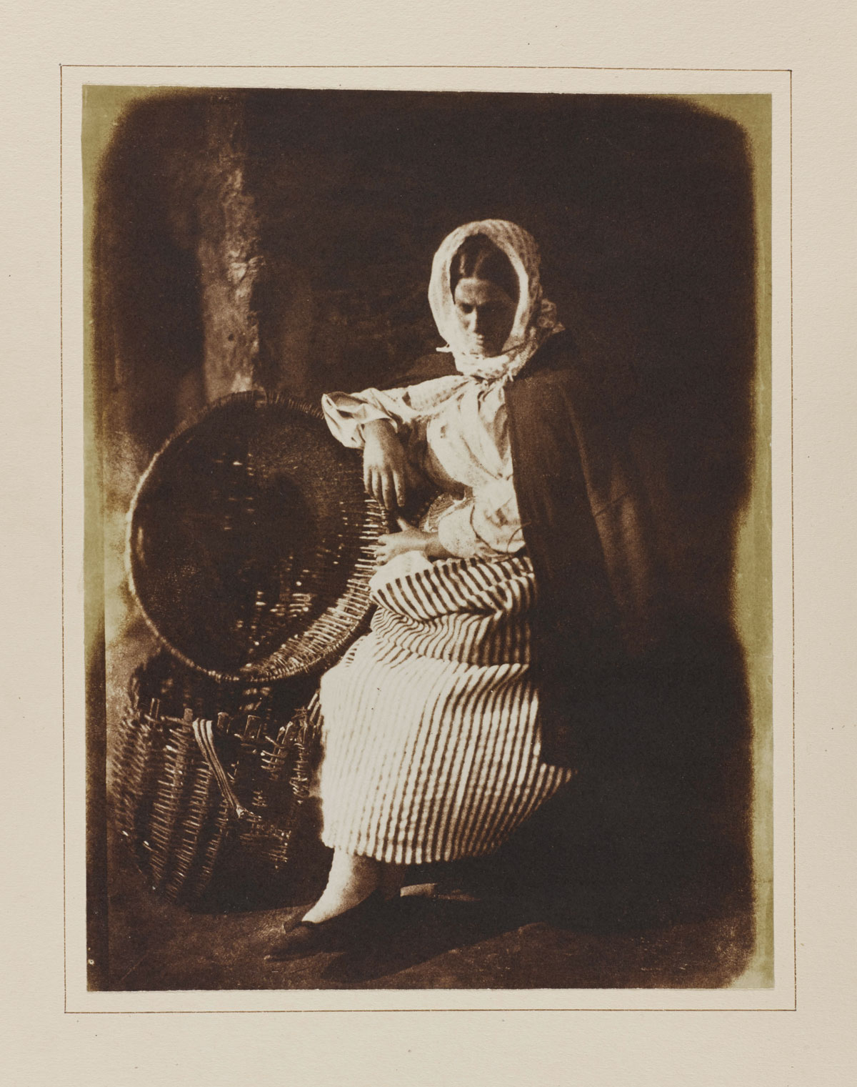 David Octavius Hill and Robert Adamson<br />Mrs Elizabeth (Johnstone) Hall, a Newhaven fishwife, famous for her beauty and self-confidence<br />1843-48<br />From an album presented by Hill to the Society of Antiquaries of Scotland in 1850<br />Salt print from a calotype negative,<br />© National Museums Scotland