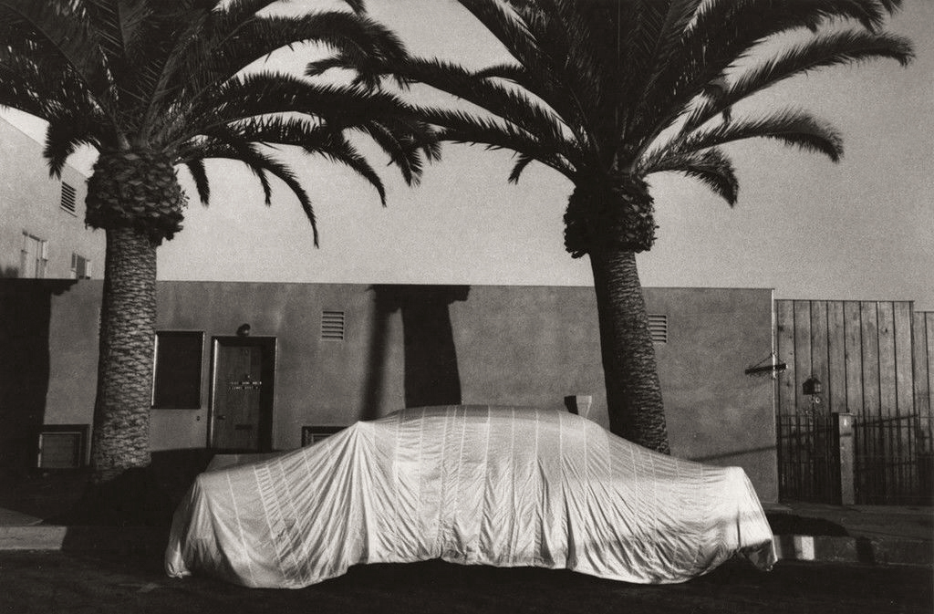 Robert Frank (American, born Switzerland, 1924)<br />Americans 34<br />Covered Car – Long Beach, California<br />1956<br />Gelatin silver print<br />Image: 21.4 x 32.7 cm (8 7/16 x 12 7/8 in.)<br />Lent by The Metropolitan Museum of Art, Gilman Collection, Purchase, Ann Tenenbaum and Thomas H. Lee Gift, 2005<br />Photograph © Robert Frank, from The Americans