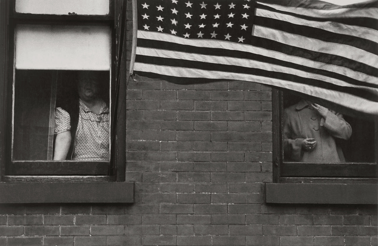 Robert Frank (American, born Switzerland, 1924)<br />Americans 1<br />Parade – Hoboken, New Jersey<br />1955<br />Gelatin silver print<br />Image: 21.3 x 32.4 cm (8 3/8 x 12 3/4 in.)<br />Private collection, San Francisco<br />Photograph © Robert Frank, from The Americans