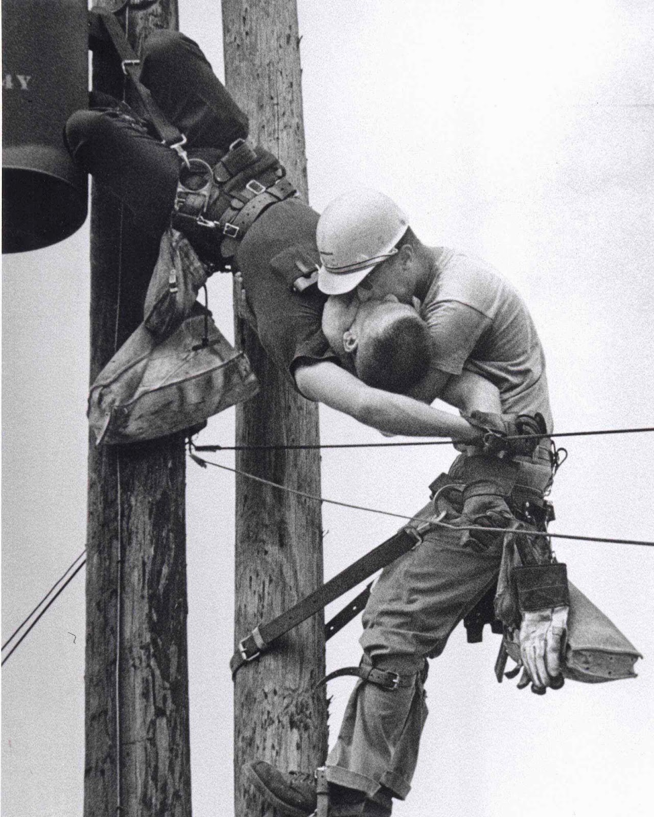 The Kiss of Life - A utility worker giving mouth-to-mouth to co-worker after he contacted a high voltage wire, 1967.jpg