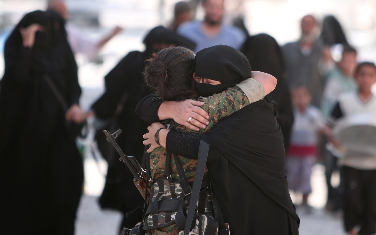 105589321_a_woman_embraces_a_syria_democratic_forces_sdf_fighter_after_she_was_evacuated_with_others_trans_nvbqzqnjv4bq-iwly18x4-czgyicjleaj2ghase0qt_uoc13qw9bqig.jpg