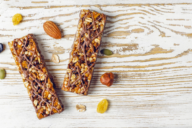 healthy-delicios-granola-bars-with-chocolate-muesli-bars-with-nuts-dry-fruits-top-view_114579-10187.jpg