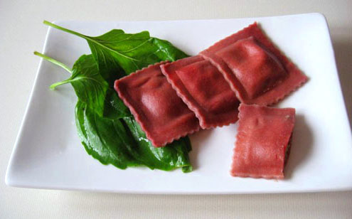 sweet potatoe and basil filling wrapped in vegan beetroot pasta_n.jpg