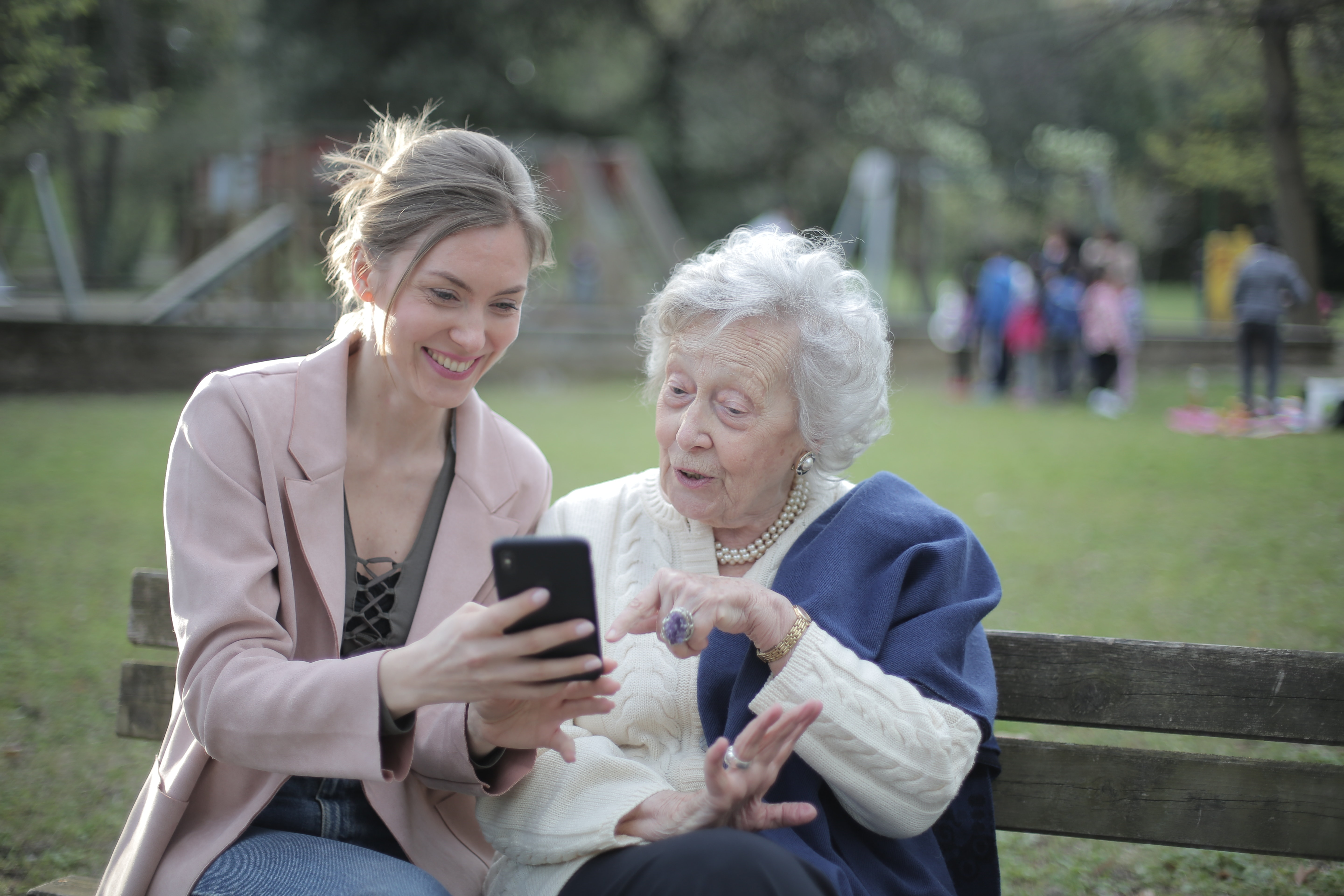 cheerful-senior-mother-and-adult-daughter-using-smartphone-3791664.jpg
