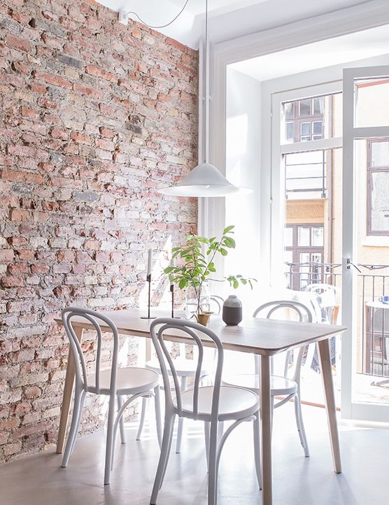 bright-and-airy-appartment-with-exposed-brick-wall-and-cute-dining-space.jpg