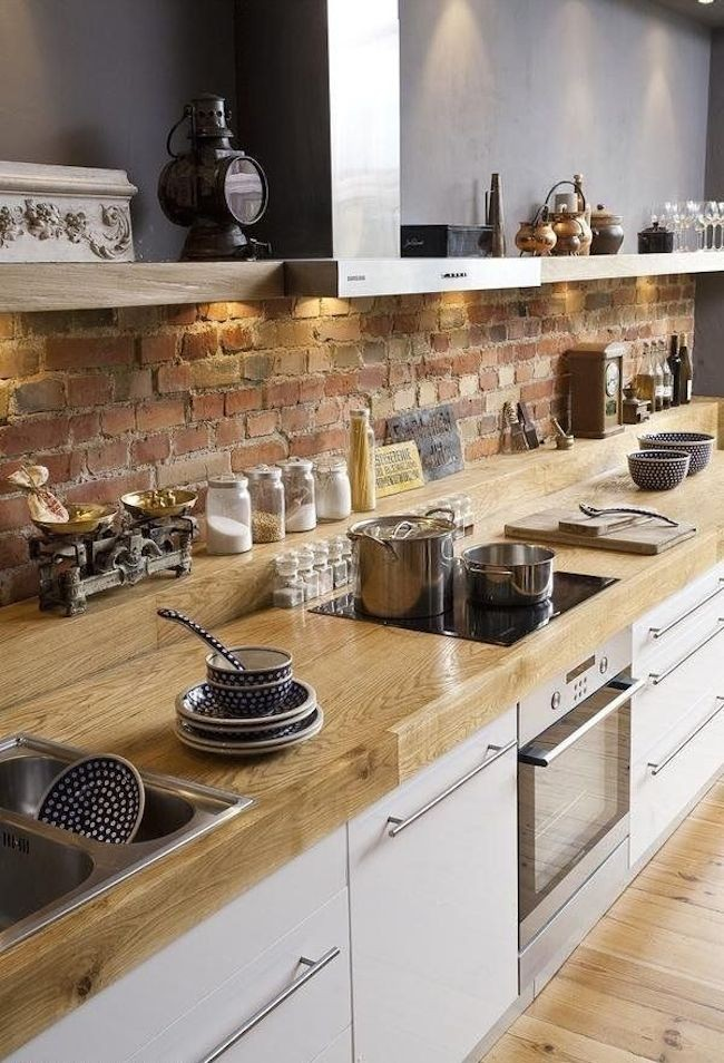 chic-and-trendy-designed-kitchen-with-sleek-appliances-and-exposed-brick-wall-.jpg