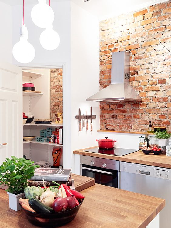 cozy-little-kitchen-with-exposed-brick-wall-and-cute-pantry.jpg
