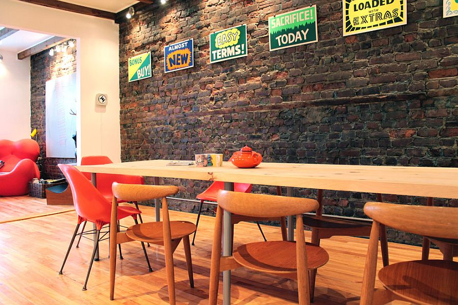 eclectically-vintage-dining-room-with-brick-wall-and-a-splash-of-color.jpg