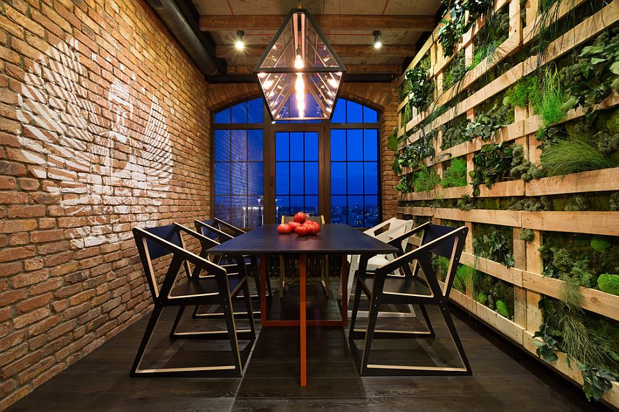 stunning-dining-room-with-green-wall-on-one-side-and-a-brick-wall-on-the-other.jpg