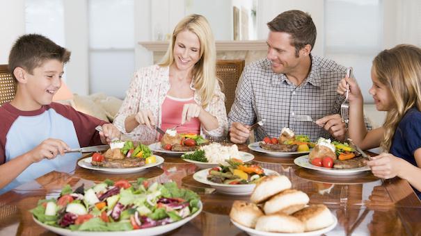 family-eating-meal-123904319-small.jpg