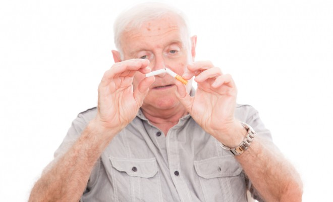 old-man-breaking-cigarette_95211721-660x400.jpg