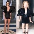 Hírességek ruháiban pózol a kislány