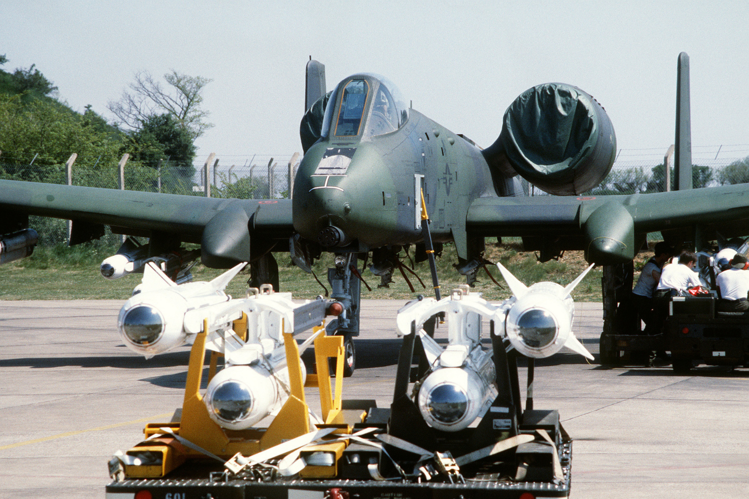 a_front_view_of_an_a-10_thunderbolt_ii_aircraft_being_uploaded_with_agm-65_maverick_bentw_81.jpg