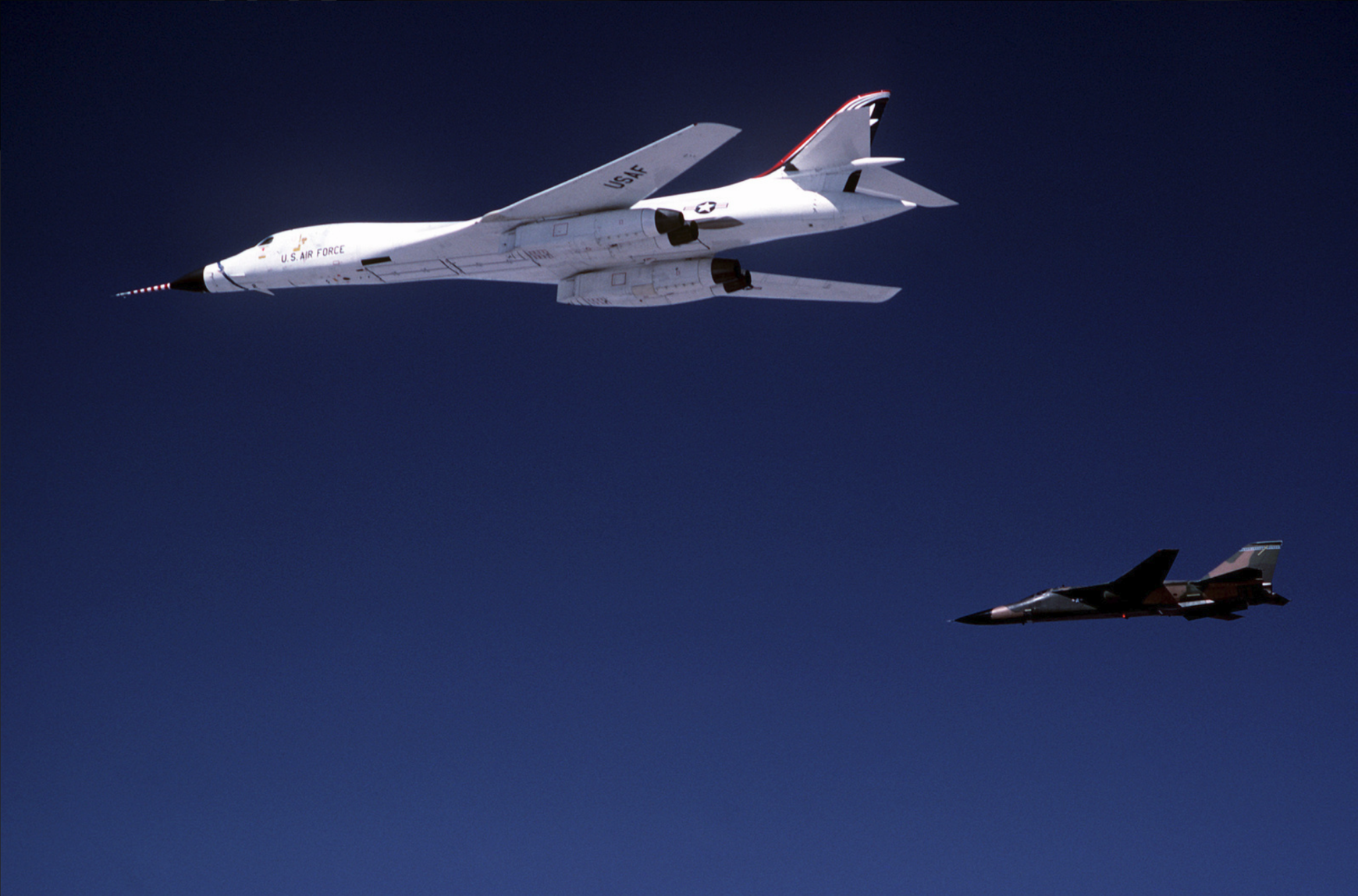 b-1b_bomber_with_an_f-111_aircraftk.png