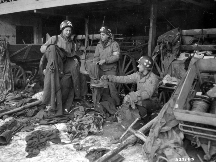 5th inf examine gi clothing diekirch.jpg