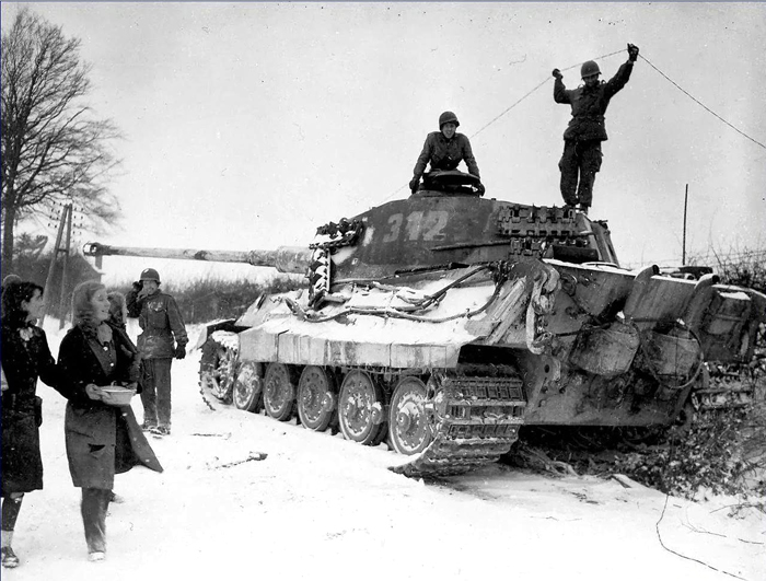 American soldiers inspecting a King Tiger Belgium 1944.jpg