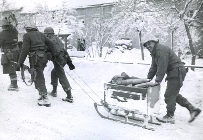 us_soldiers_sled_shells_butgenbach_belgium.jpg
