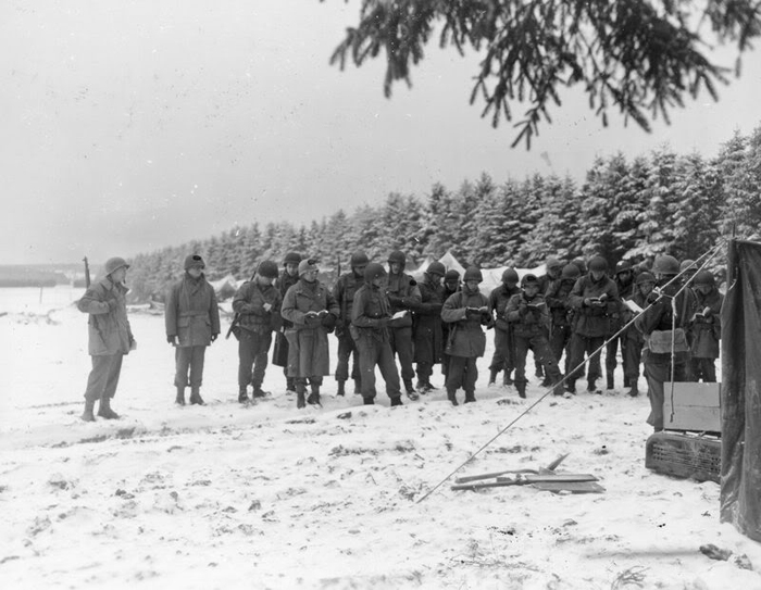 New Year's Eve Men of the 99th Inf Div listen to a Christian service.jpg