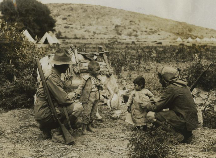 anzac_soldier_and_british_soldier_with_turkish_woman_her_children_and_donkey_2.jpg