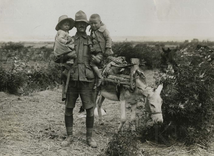 anzac_soldier_and_british_soldier_with_turkish_woman_her_children_and_donkey_3.jpg