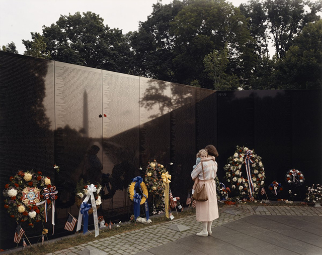 a-woman-and-child-visit-the-vietnam-veterans-memorial-in-washington-dc-1986-the-wall-which-features-the-names-of-all-those-killed-or-missing-in-action-was-completed-in-1982.jpg