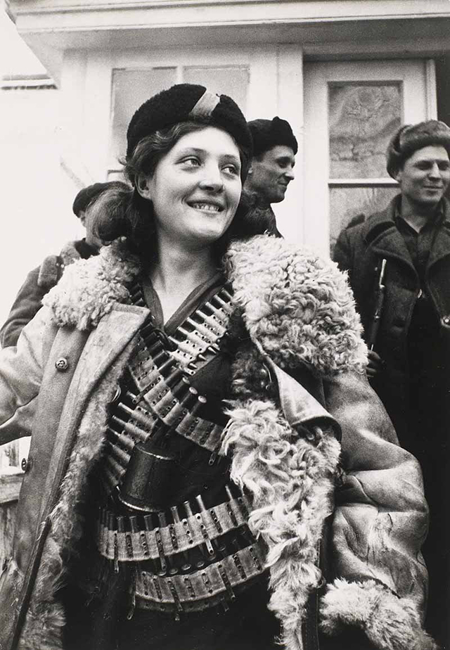 in-1942-a-russian-female-partisan-stands-covered-in-ammunition.jpg