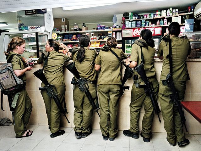 military-service-is-mandatory-for-all-israelis-fifteen-years-after-completing-her-own-service-israeli-photographer-rachel-papo-documents-young-female-soldiers-buying-things-at-a-military-kiosk-counter-in-2004.jpg