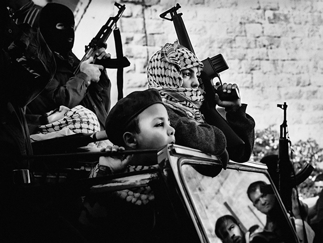 young-members-of-fatah-a-major-palestinian-political-party-at-the-funeral-procession-of-a-palestinian-fighter-in-2002.jpg
