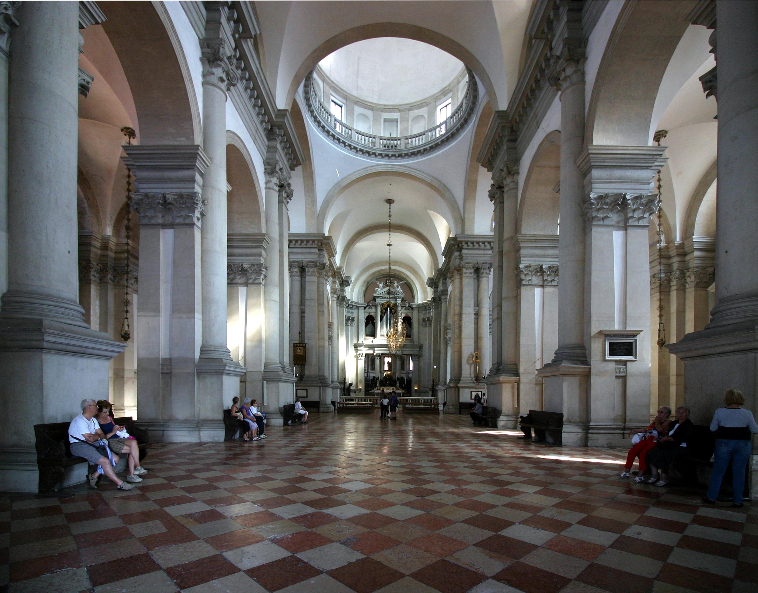 San Giorgio Maggiore templom belseje, Velence<br /><br />Belül masszív oszlopok és pilaszterek, fehér falak, többek között Tintoretto festményei díszítik.<br /><br />Kép: Wikimedia Commons / José Luiz Bernardes Ribeiro