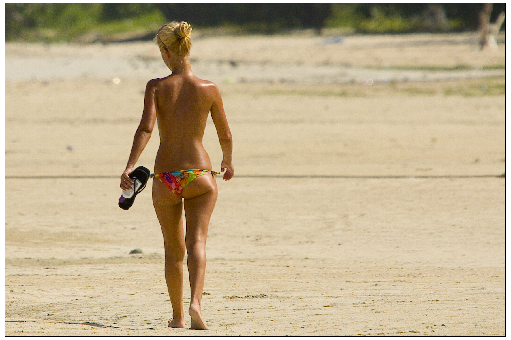 a_woman_with_a_suntan_wearing_a_bikini_3.jpg