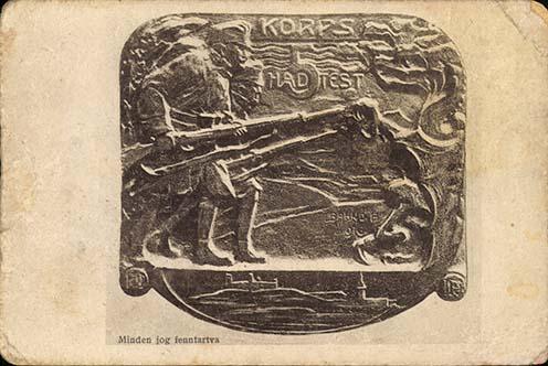 A pozsonyi 5. hadtest sapka-plakett tervezete, amit a m. kir. Rokkantügyi Hivatal Pozsonyi Intézetének egyik rokkantja, Báhnó Pál szobrász mintázott. Korabeli képeslap