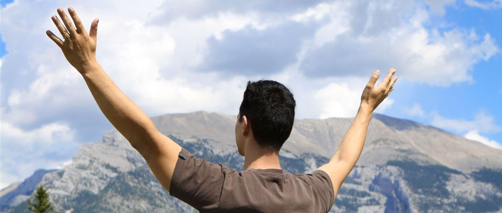 prayer-man-with-lifted-hands-in-front-of-mountain.jpg