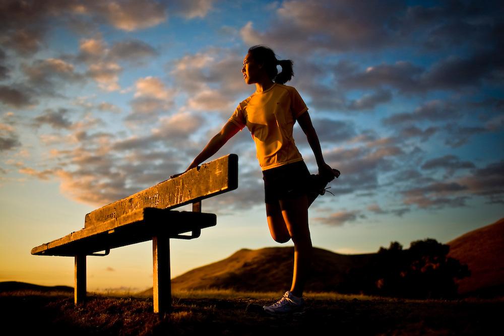 woman-stretching-runner-female-asian-landscape-sunset-yellow.jpg