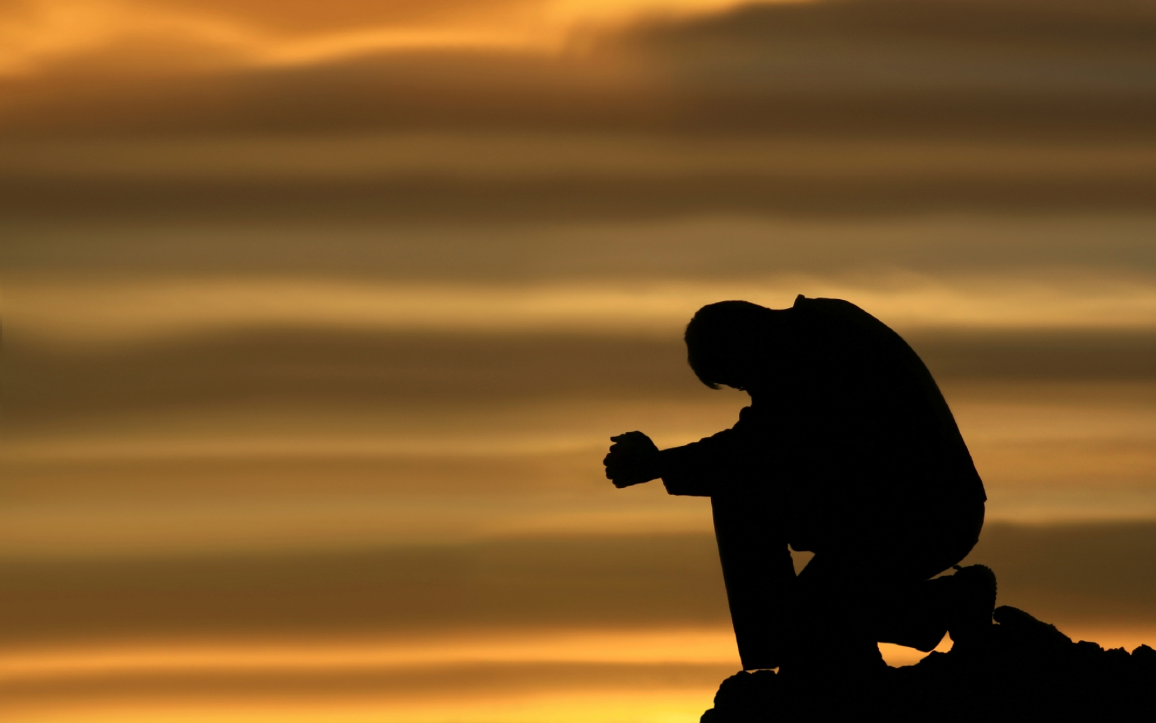 praying-and-kneeling-man.jpg