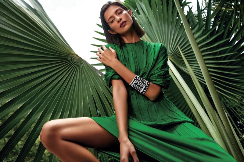 model-outdoors-green-top-skirt-leaves-fashion-photo.jpg