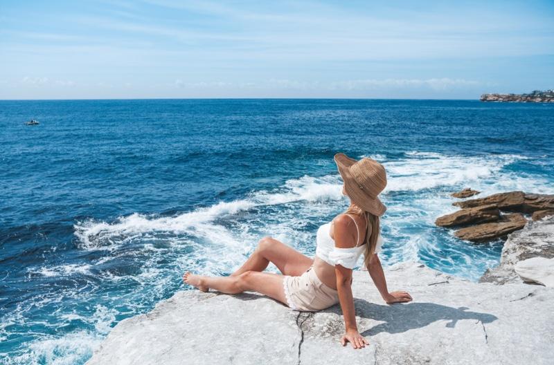 woman-relaxing-australia-beach-travel.jpg