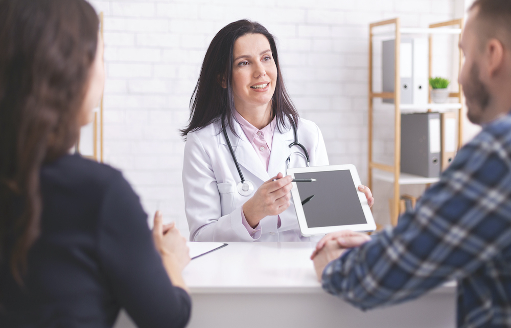 doctor-showing-test-results-on-digital-tablet-to-nyzfbnn.jpg