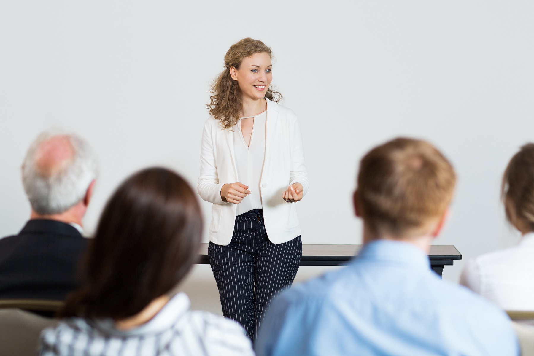 business-woman-giving-lecture.jpg