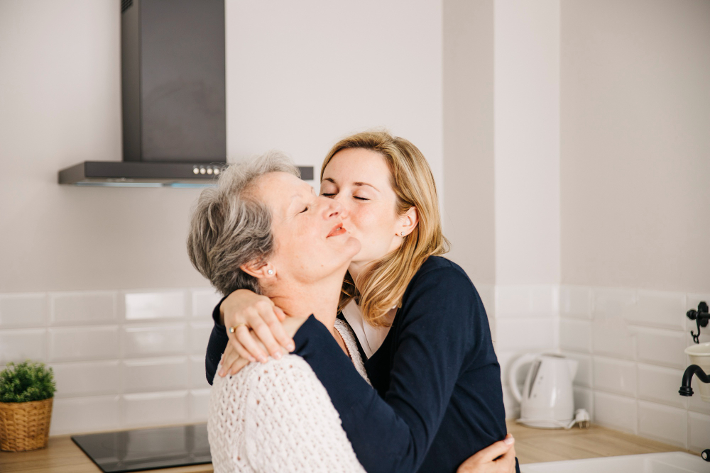 daughter-kissing-mom-mothers-day.jpg