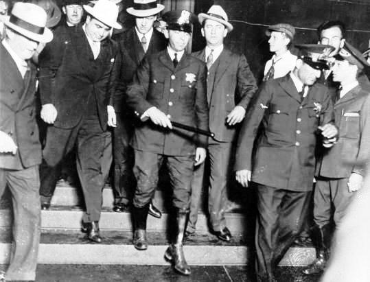 Capone-with-police.jpeg