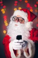 stock-photo-50652792-hipster-santa-claus-taking-selfie-on-cell-phone.jpg