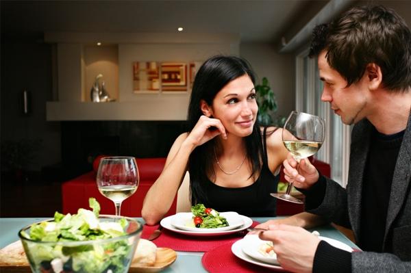 happy-couple-at-home-having-dinner.jpg